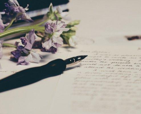 letters pen flowers spelling