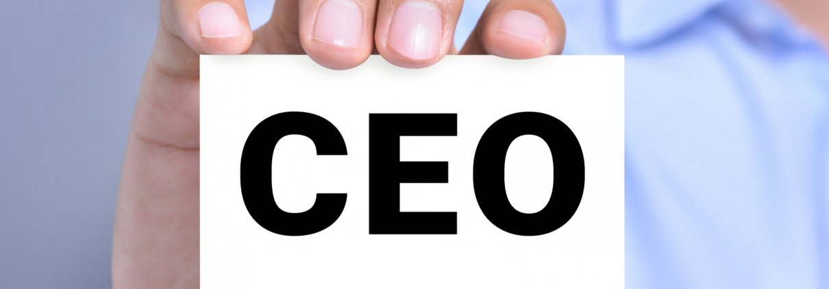 CEO letters (or Chief Executive Officer) on the card shown by a man