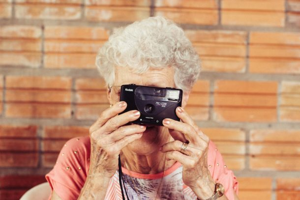 too old for technology older woman with camera