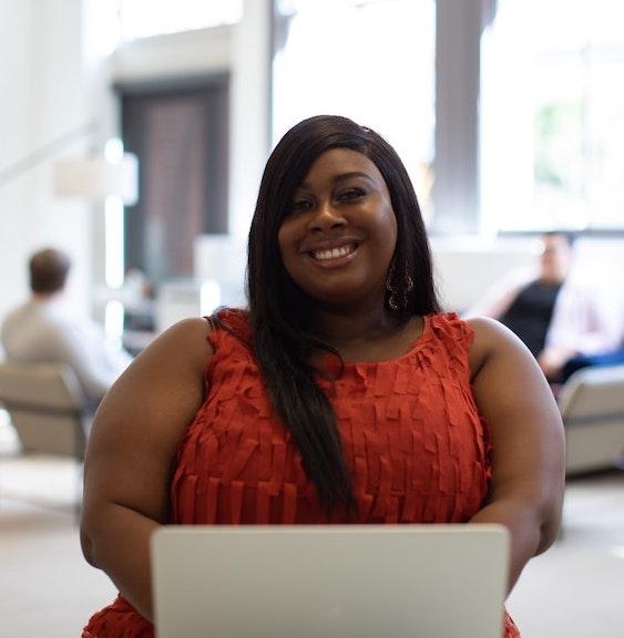 smiling black woman at computer | blog post topics