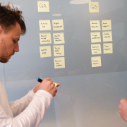 man writing on post its | blog content