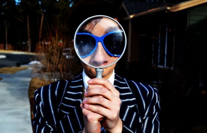 man magnifying glass remove personal info