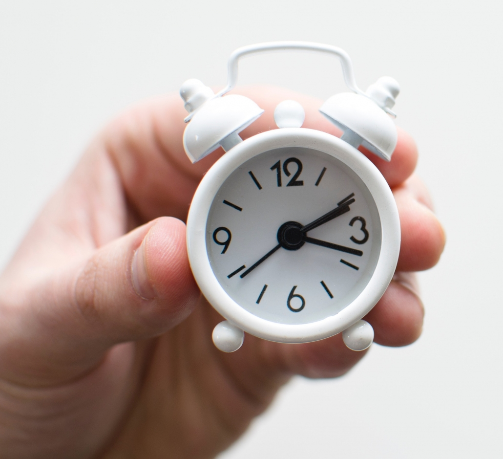 volunteer your time hand holding white clock
