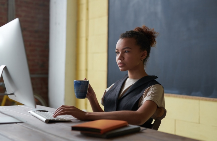 teach online photo-of-woman-holding-mug